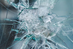 Firearms bullethole on bulletproof glass, cracks background Royalty Free Stock Photography