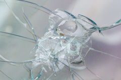 Firearms bullethole on the glass from the bullets, cracks background Royalty Free Stock Photos