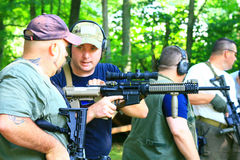 Firearms Class. Trainers, instructors, and experienced shooters offer their knowledge and skills during this Carbine 101 Course offered at Mayberry Range in stock images