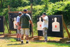 Firearms Class. Trainers, instructors, and experienced shooters offer their knowledge and skills during this Carbine 101 Course offered at Mayberry Range in stock photos