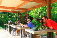 Firearms Class. Trainers, instructors, and experienced shooters offer their knowledge and skills during this Carbine 101 Course offered at Mayberry Range in royalty free stock image