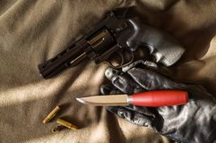 Firearms and edged weapons. Knife and gun. Top view stock photos