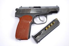 Firearms of limited defeat the service pistol is near the lying loaded shop with cartridges. It is isolated stock photography