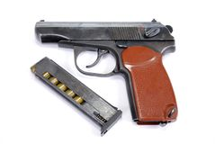 Firearms of limited defeat the service pistol is near the lying loaded shop with cartridges. It is isolated stock photos