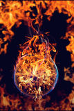Fireball. On burning fire flame background Royalty Free Stock Images