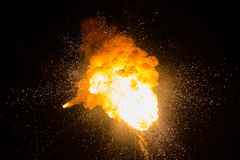 Fireball: explosion, detonation. Realistic fiery explosion with sparks over a black background Stock Image