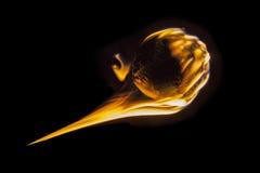 Fireball Fastball. Flaming fireball fastball baseball burning into darkness stock photo
