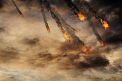 Fireballs in the Sky. Grunge fireballs with smoke tails over cloudy background Stock Photo