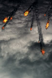 Fireballs in the Sky. Grunge fireballs with smoke tails over cloudy background Stock Photos