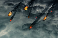 Fireballs in the Sky. Grunge fireballs with smoke tails over cloudy background Stock Photography