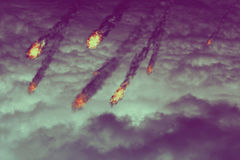 Fireballs in the Sky. Grunge fireballs with smoke tails over cloudy background Royalty Free Stock Photo