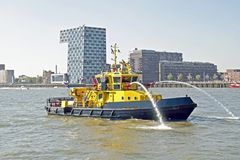 Fireboat in the harbor from Rotterdam Netherlands Royalty Free Stock Photography