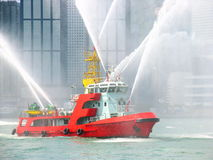 Fireboat In Hong Kong City Stock Photo