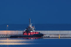 FIREBOAT ON A MOONLIT NIGHT stock image