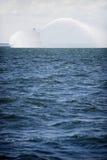 Fireboat na ação no mar Fotos de Stock Royalty Free