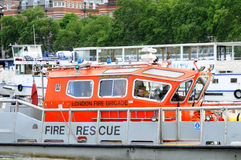Fireboat on the Thames. The London Fire Brigade (LFB) is the statutory fire and rescue service for London Stock Image
