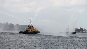 Fireboats casting water streams. In celebration during Riga marathon stock video