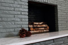 Firebox In Painted Brick Fireplace Stock Photo