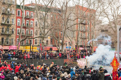 Firecracker Ceremony Chinese New Year - Chinatown, New York City. The smoke from the Firecracker Ceremony filled the square at Sara D. Roosevelt Park in Stock Photo