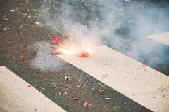 Firecracker exploding on the asphalt of a street Royalty Free Stock Photos
