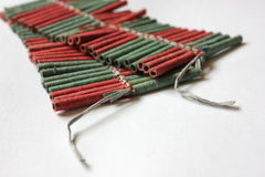 Firecrackers. Two sets of red and green firecrackers Royalty Free Stock Photo