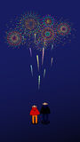 Watching Fireworks. A girl and a boy are watching the fireworks flowering in the sky,Fairworks,smoke flowerage Stock Image