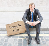 Fired businessman. Sitting on the stress looking for a job Royalty Free Stock Photos