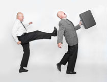 Fired businessman. Fired businessman and angry boss. Funny picture from office Royalty Free Stock Photography