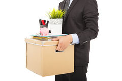 Fired businessman carrying his belongings. Isolated on white Royalty Free Stock Image