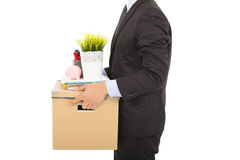 Fired businessman carrying his belongings. Over white Royalty Free Stock Photography