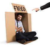 Fired businessman. Desperate and fired businessman hides in the cardboard Royalty Free Stock Photo
