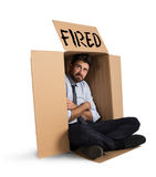 Fired businessman. Desperate and fired businessman hides in the cardboard Stock Photo
