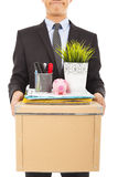 Fired businessman felling sad and belongings Royalty Free Stock Image