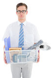 Fired businessman holding box of belongings Royalty Free Stock Images