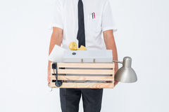 Fired businessman holding box of belongings Stock Photos