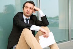 Fired businessman reading  job termination Royalty Free Stock Photography
