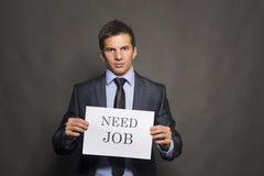 Fired businessman searching for a job Stock Photos