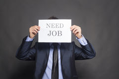 Fired businessman searching for a job Stock Photography