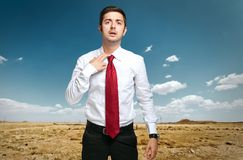 Fired businessman sweating in the desert Royalty Free Stock Image