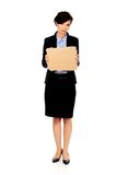 Fired businesswoman with a cardboard. Stock Photo