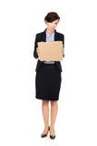Fired businesswoman with a cardboard. Royalty Free Stock Photos