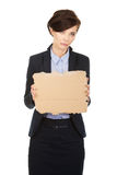 Fired businesswoman with a cardboard. Stock Image