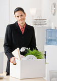 Fired businesswoman carrying box. Fired businesswoman carrying her belongings Stock Photos
