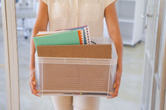 Fired businesswoman holding box of her things Stock Images