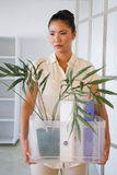Fired businesswoman holding box of her things Stock Image