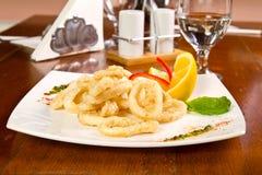 Fired calamari. Fried calamari rings with lemon Stock Photo