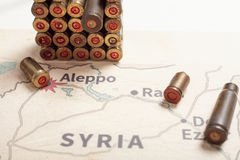 The fired cases and bullets from rifle. Background view on section area of Aleppo, Syria. Royalty Free Stock Photos
