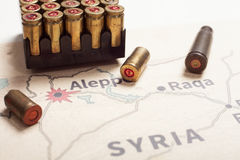 The fired cases and bullets from rifle. Background view on section area of Aleppo, Syria. Royalty Free Stock Photo