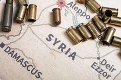 The fired cases and bullets from rifle. Background view on section area of Aleppo, Syria. Stock Photos