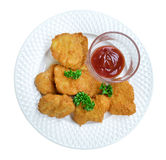 Fired chicken nuggets with sauce in ceramic plate top view isolated on white background, path Royalty Free Stock Images